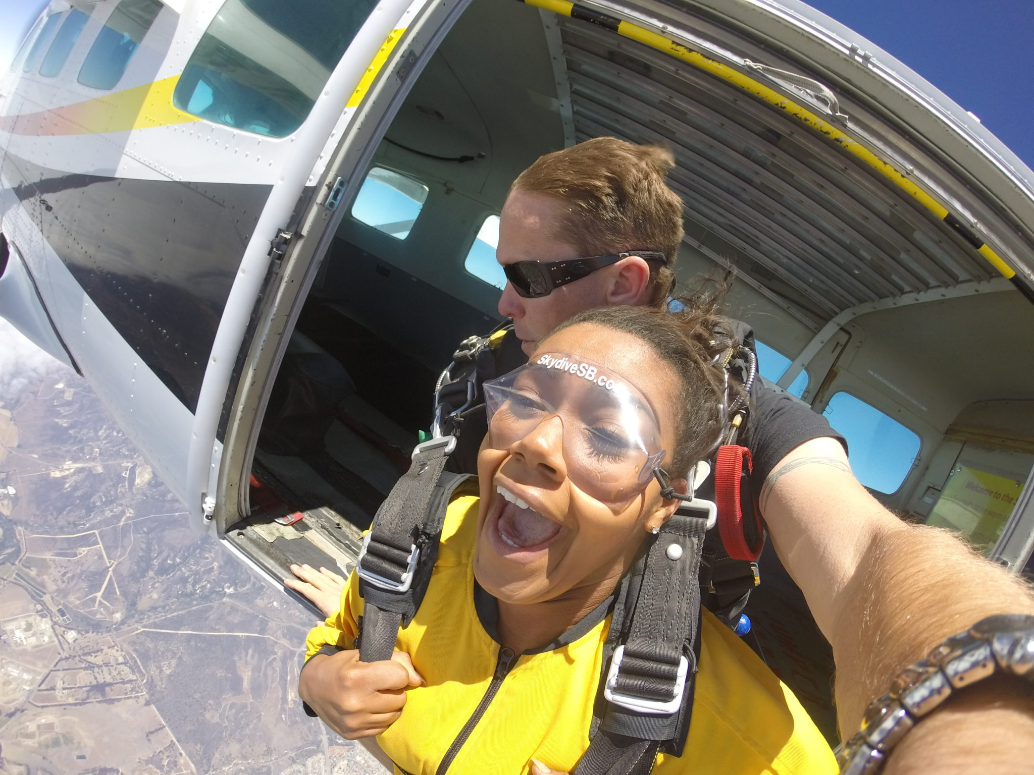 tandem skydivers jumping out of plane