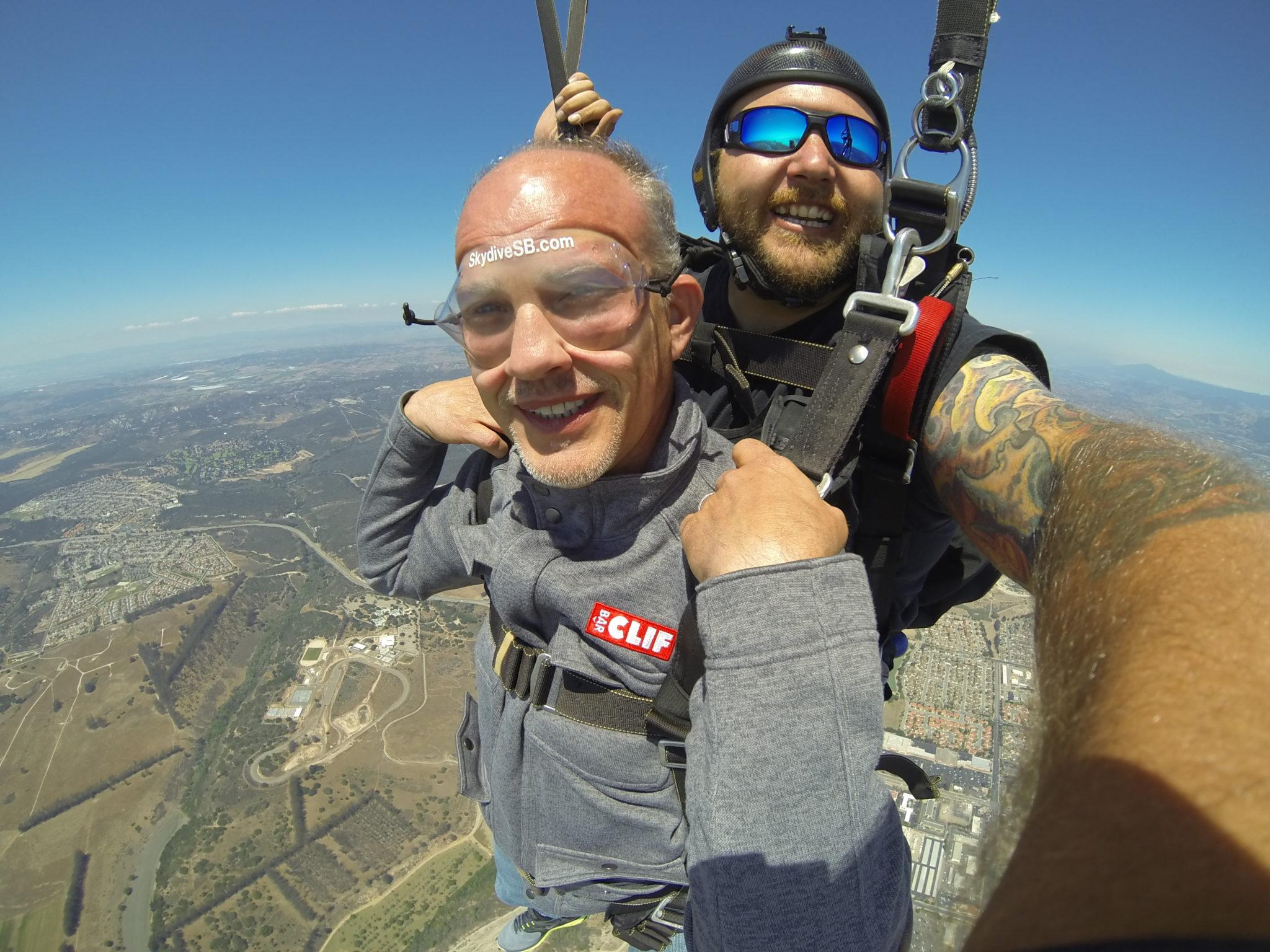 tandem skydivers smiling